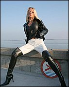 Sexy blonde woman in leather top and white tight pants smoking.jpg