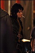 Kristen-and-her-black-leather-jacket-Smoking-2-She-look-good-LOL-twilight-series-7338530-415-627.jpg