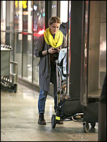 Evan Rachel Wood - Smokes an E-Cigarette Upon Her Arrival at LAX December 29, 2016 09.jpg