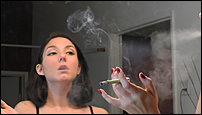 Click image for larger version.  Name:Lily Marlene - Smoking and Putting on Makeup - RAW pt1.00_11_57_48.Still004.jpg Views:37 Size:640.9 KB ID:4012118